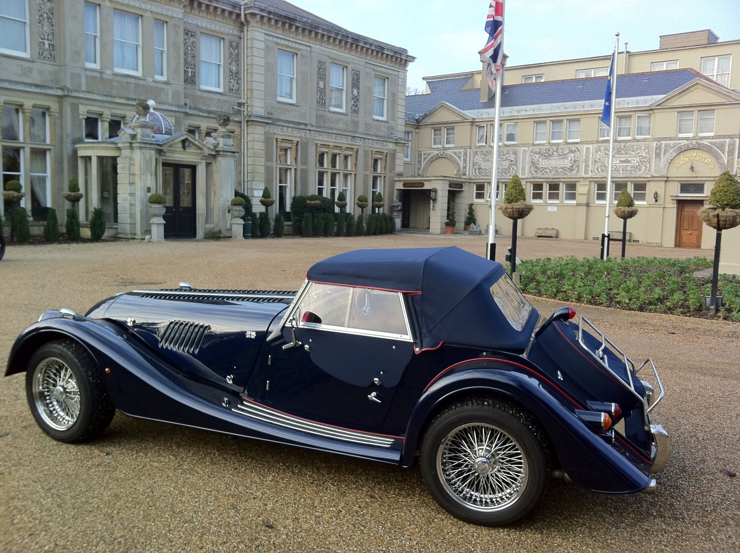 A beautiful Morgan car in front of Down Hall Country House Hotel