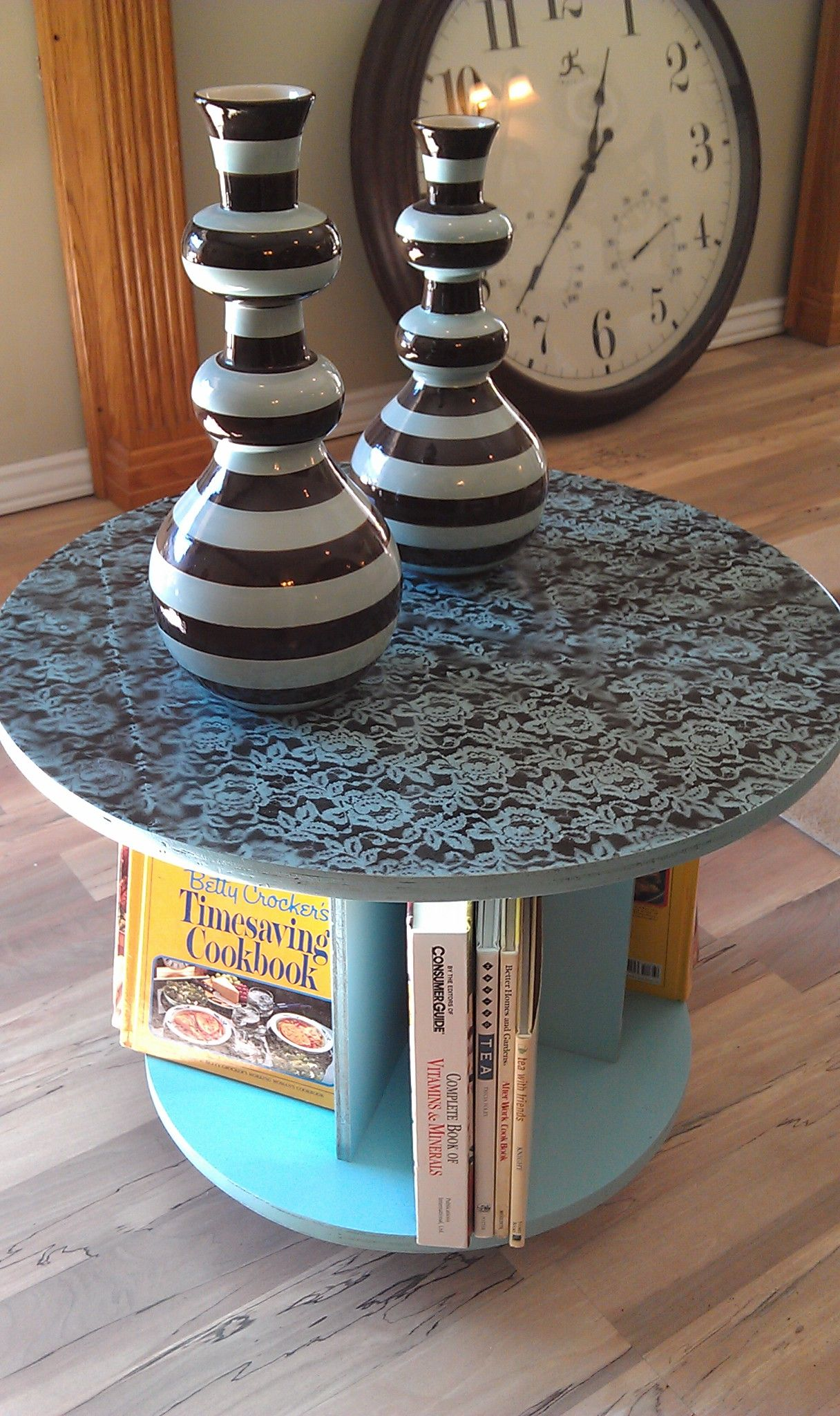 An old cable spool made into an end table great for books