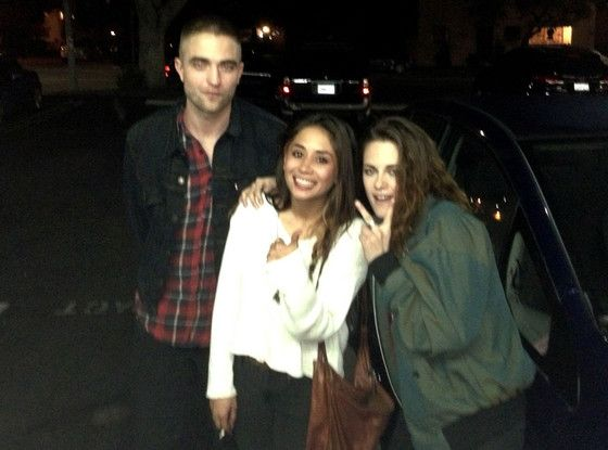 Robert Pattinson, Kristen Stewart pose with a fan on 3/19/13. I LOVE what Kristen said to the fan when she nervously asked if she'd take a picture with her.
