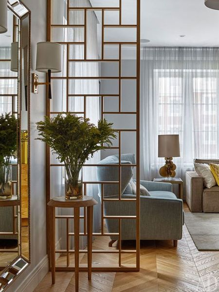 a simple wood partition as a room divider is an easy way