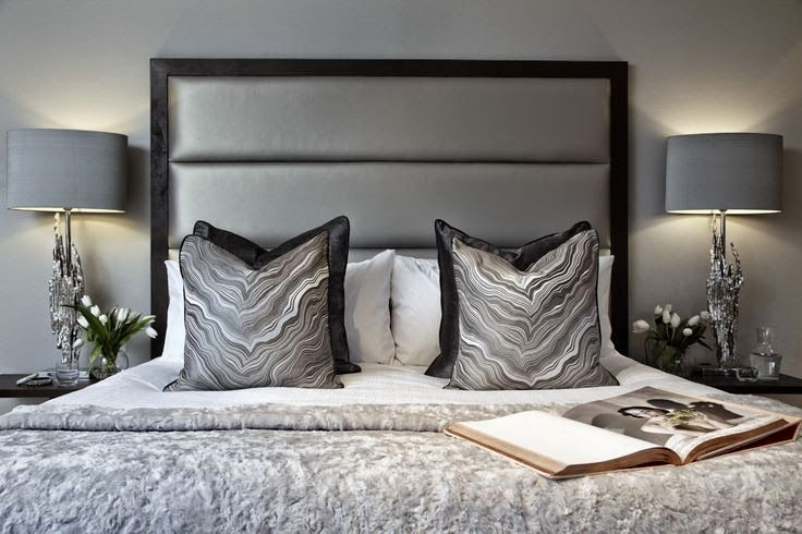 TBoscolo   high metallic leather upholstered headboard  luxury silk cushions  and fur throw in a. TBoscolo   high metallic leather upholstered headboard  luxury