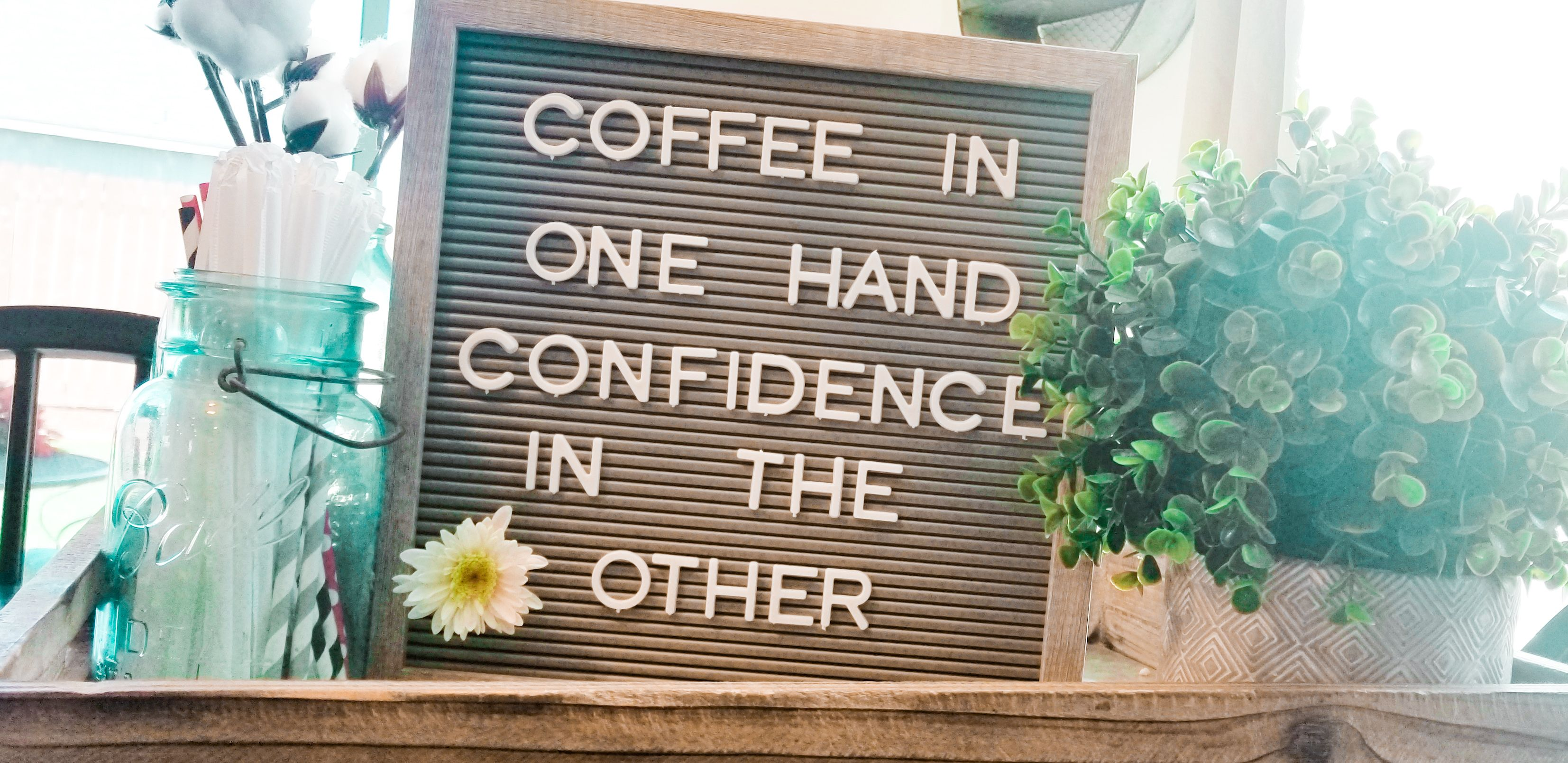 Coffee In one hand confidence in the other letterboard in
