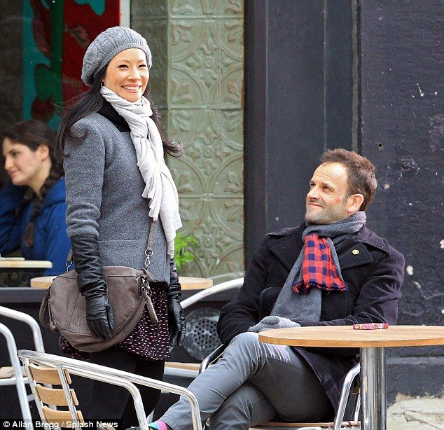 Lucy Liu bundles up in beret and scarf as she films scenes for Sherlock Holmes drama Elementary