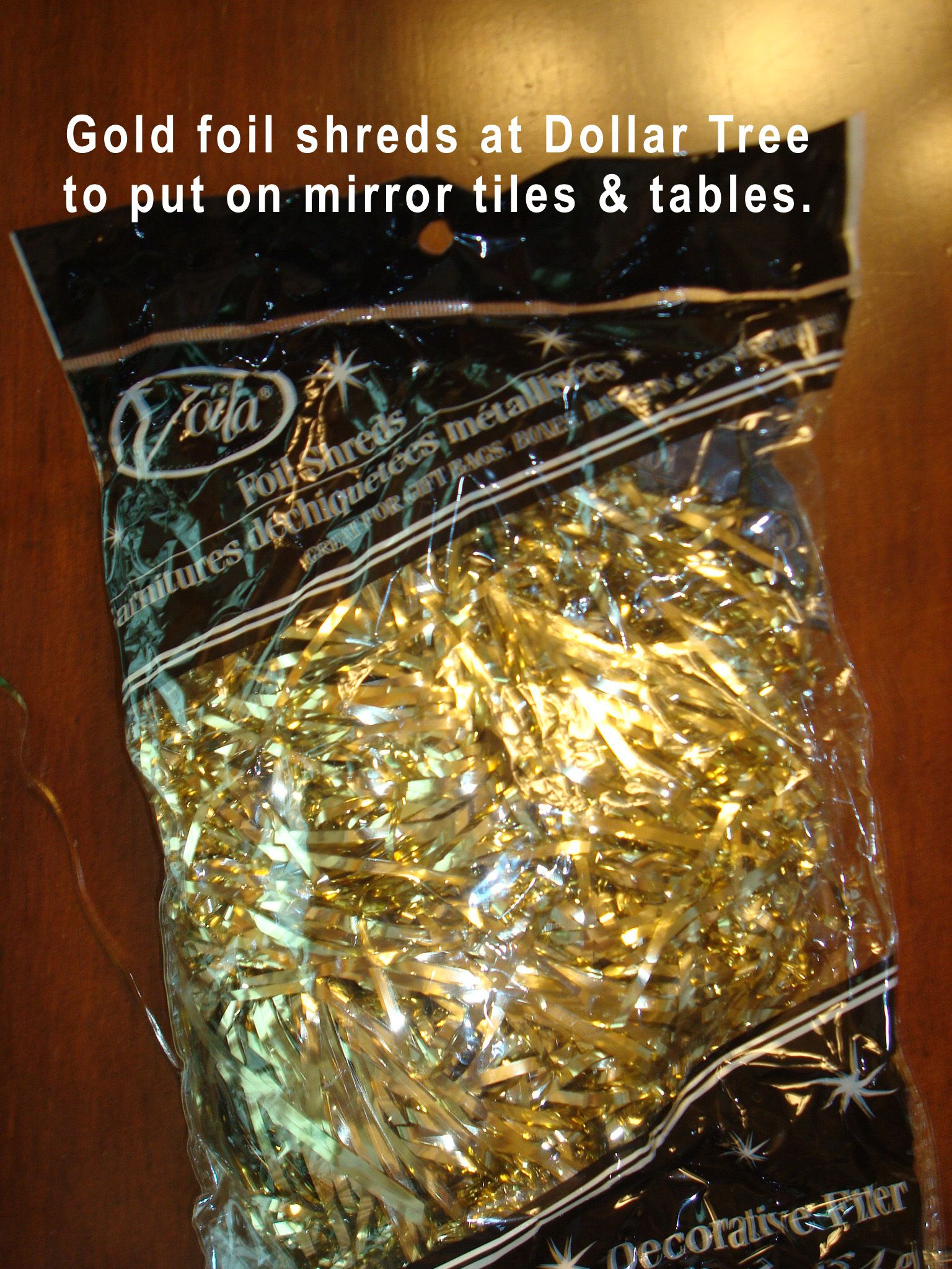 Dollar tree gold foil shreds were scattered on centerpiece