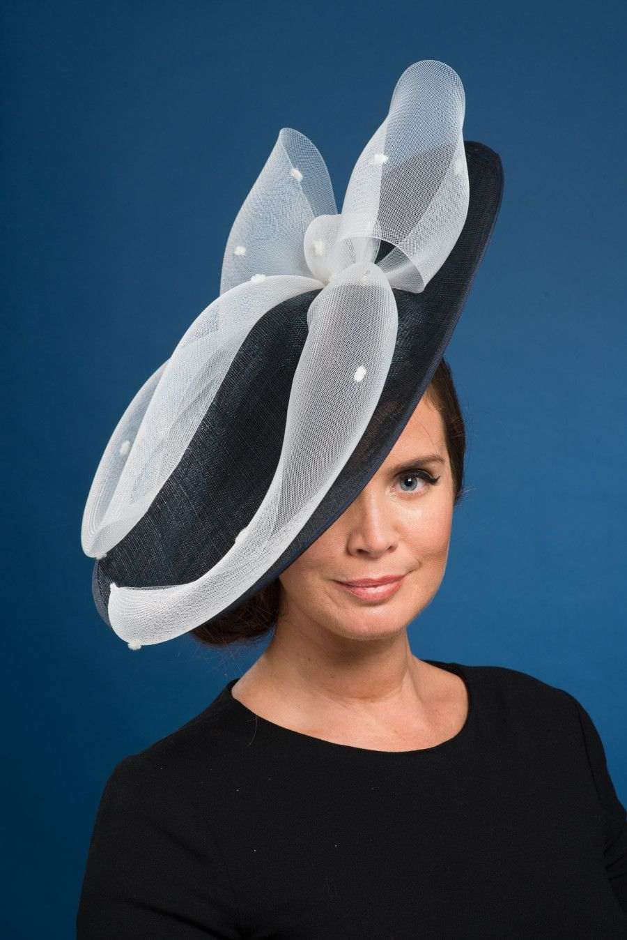 Large dark navy sinamay saucer adorned with ivory spot crinoline bow  Features Can be made in 502c4be89a0f