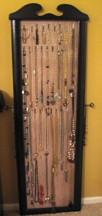 I wanted something to hang my jewelry on, but didn't want to spend hundreds for a stand. I took a mirror frame (the mirror was broken), backed it with hardware cloth, some fabric and batting -- and then attached picture frame hooks on the wires to hang bracelets and necklaces. You can adjust placement according to length of necklaces. Easy project! You could hang it on the wall or a door, but I just prop it up against the wall.