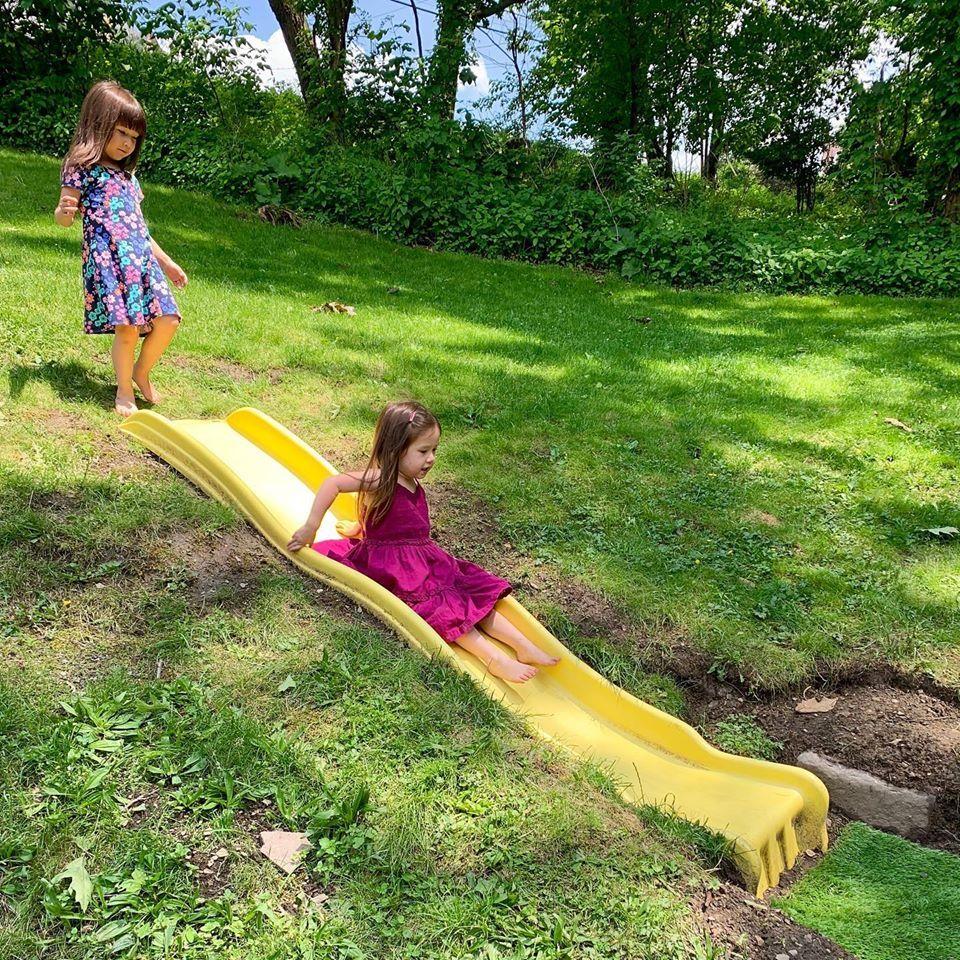 Diy Hillside Slide Step By Step Instructions Momtessori Life Backyard Slide Sloped Backyard Playground Landscaping Diy backyard hill slide