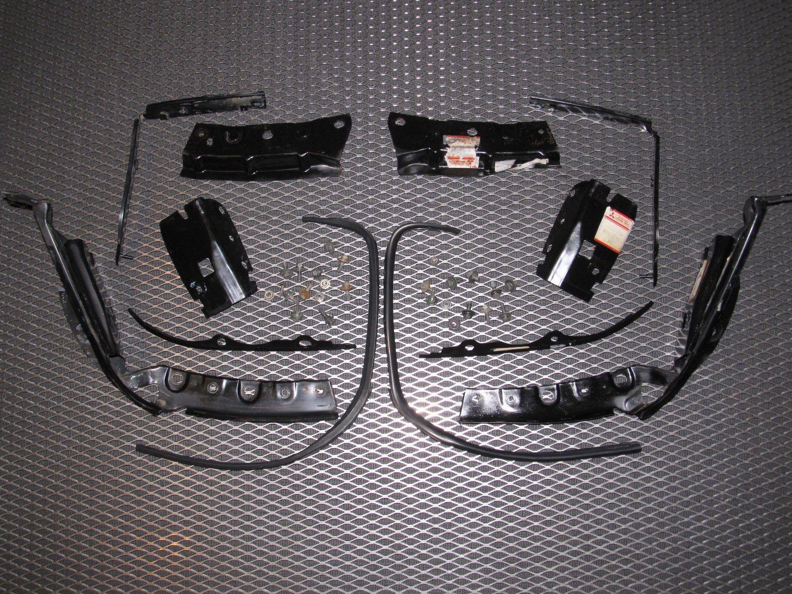 94 95 96 97 Mitsubishi 3000GT OEM Headlight & Bumper Bracket