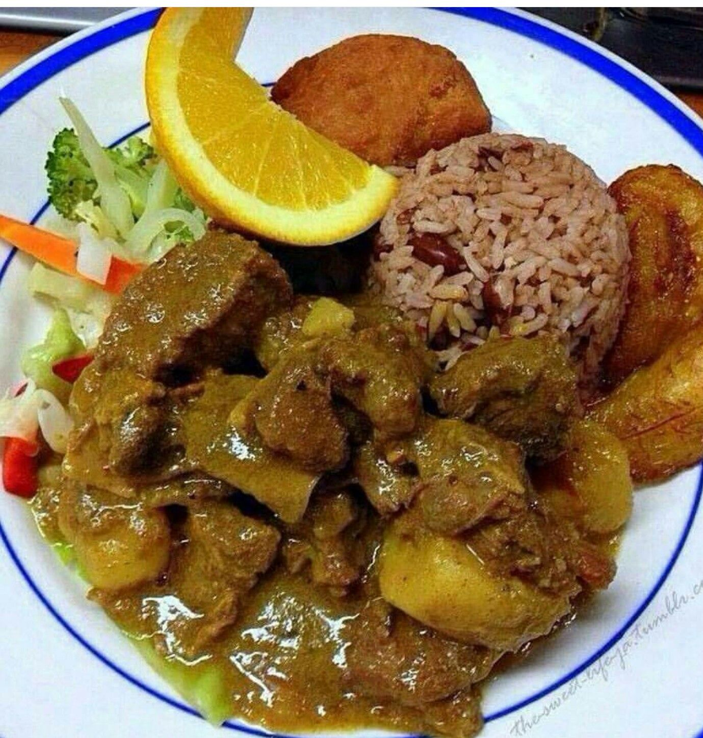 curry goat with rice and peas jamaican food  goat