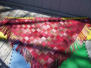 Triangle Entrelac Shawl.  I used Noro Silk garden in a blue colorway and an I cord edging.