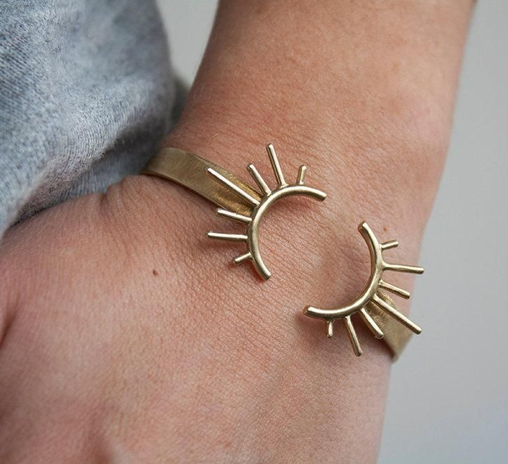 Warm up your look with an adjustable sunburst bangle. #etsyjewelry