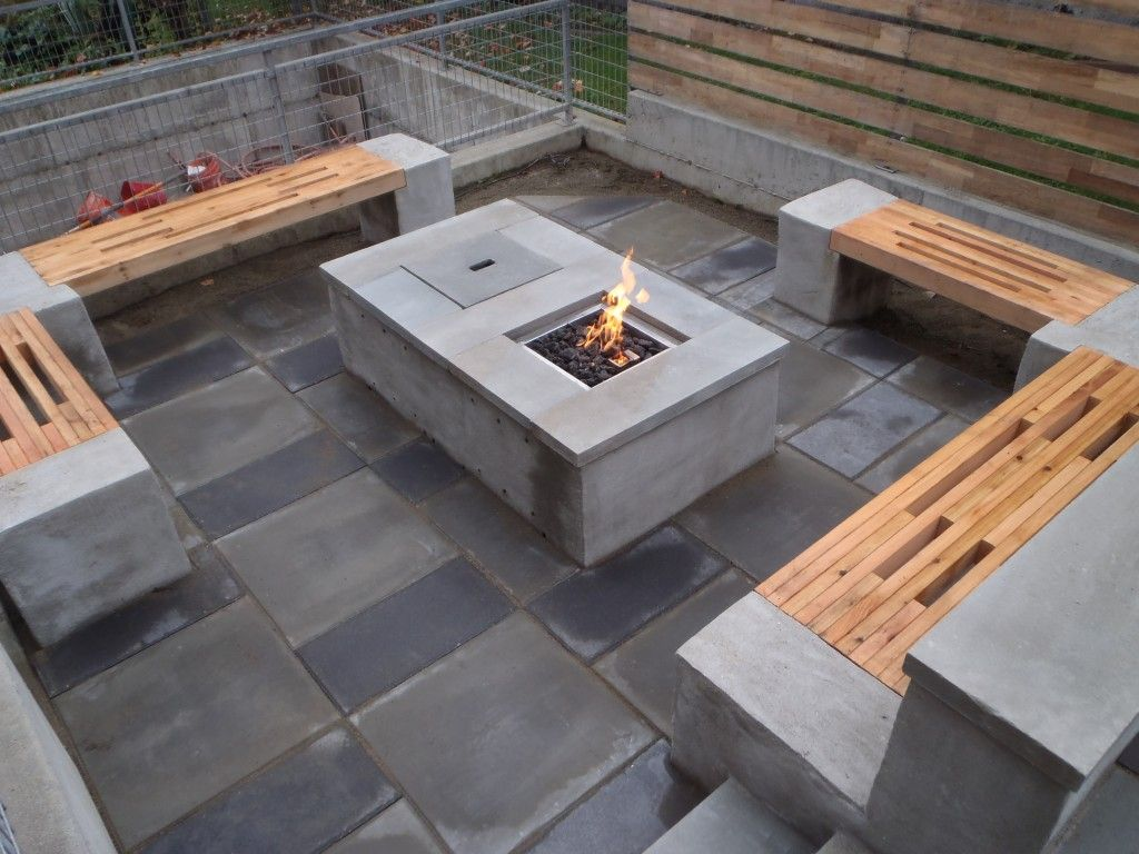 the benches consist of stuccoed concrete blocks which support tops  - accessories  interactive outdoor living space decoration with rectangulargrey modern gas fire pit along with cement garden bench and grey stoneoutdoor