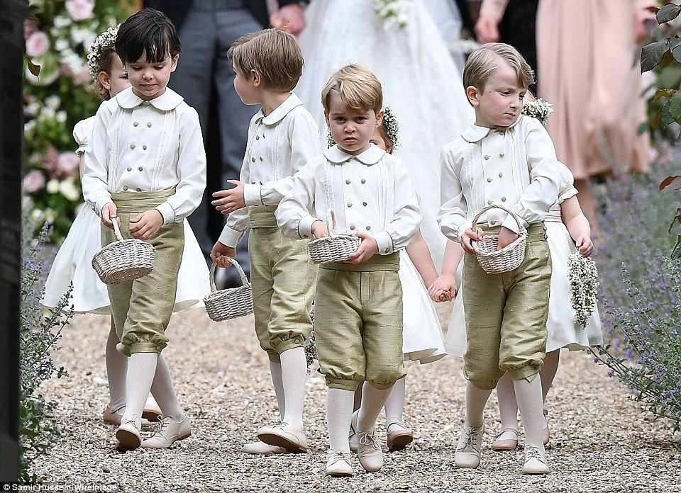 Here come the boys! The pageboys put on an adorable display as they threw petals following...
