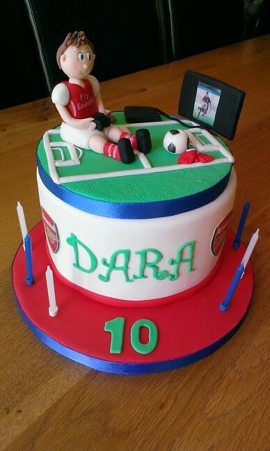 Arsenal supporter playstation fan cake Made by Cakes Bakes
