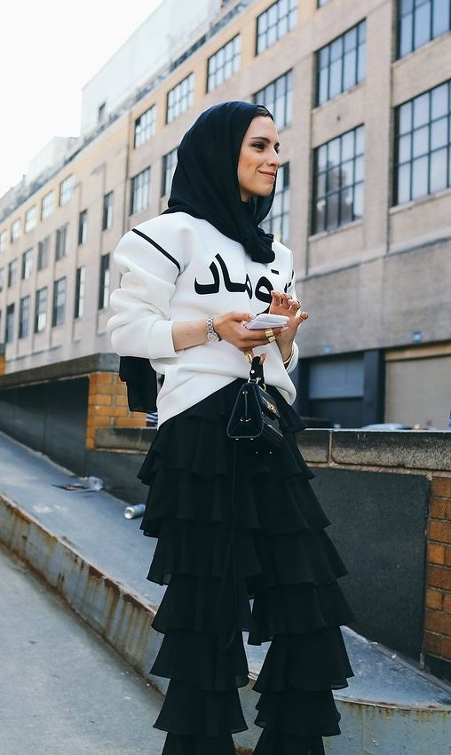 On the street at New York Fashion Week. Photographed by Phil Oh.