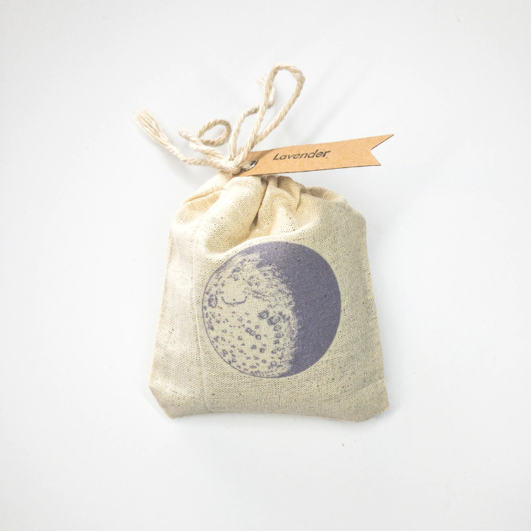 """The fragrance from the oils of the lavender plant is believed to help promote calmness and wellness, helping to reduce stress and anxiety. This lavender sachet is the perfect pouch to add to any drawer, closet, or storage space, so that you can carry a light scent of lavender wherever the day takes you! This 100% muslin, 4""""x3"""" sachet is filled with pure dried lavender flowers."""