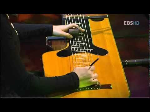 "A very beautiful piece performed by Yu Kyung-hwa (and friends) featuring the rare Korean musical instrument, the Chulhyungum (lit. ""steel-string instrument). Lovely music... sounds a little like a Hawaiian guitar but beautiful and distinctive."