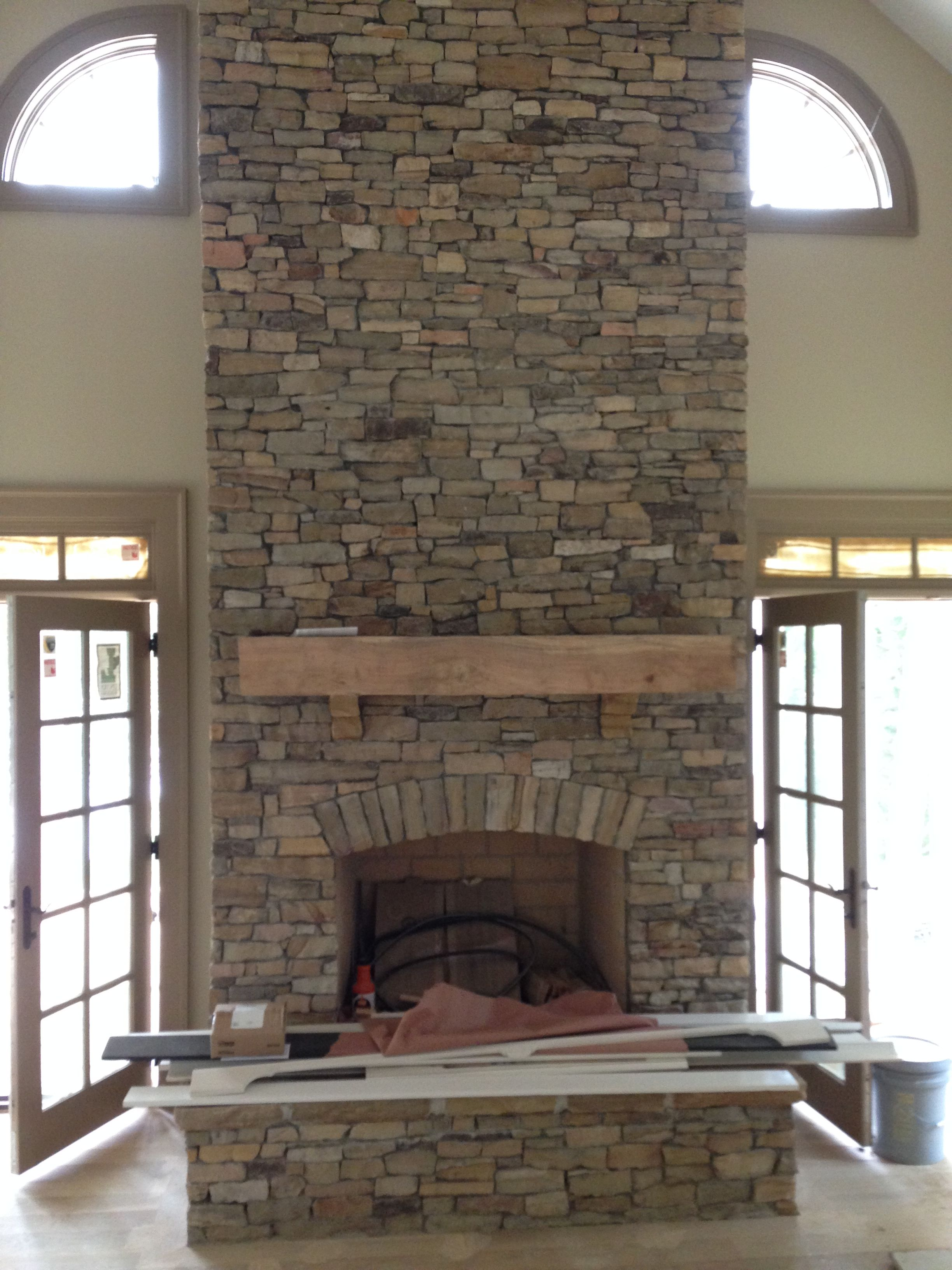 Porch and Stone veneer fireplace