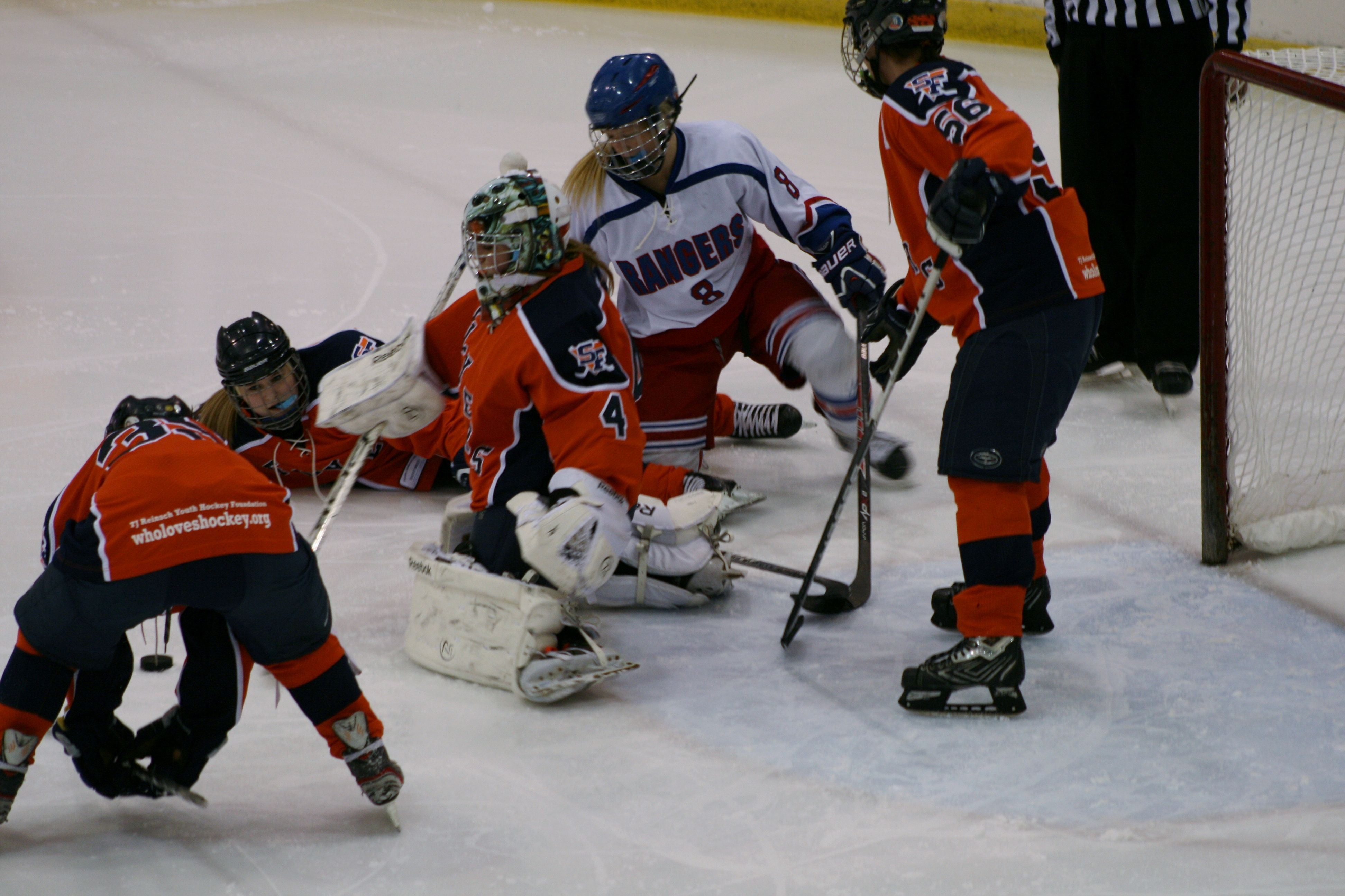 """""""Ninja Saves"""" Photo taken by Angela Drake Photo was taken on 03/09/14. Photo is of Youth Hockey for Sioux Falls Lady Flyers vs. Brookings Rangers in the youth division of Girls Varsity. Players in the photo are Brittany Corcoran — at George E Maas Ice Center, Watertown, SD."""