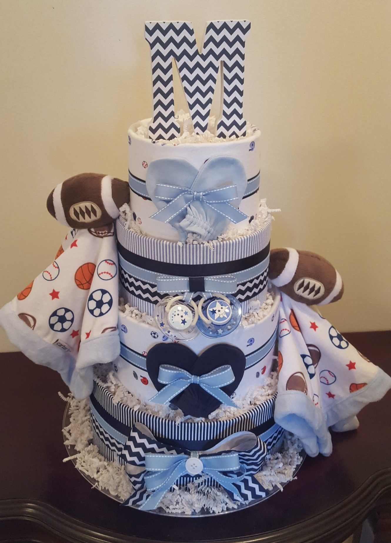 Sports Themed Diaper Cake Twin Boys Baby Shower Centerpiece Gift Visit My Facebook Pag Boy Baby Shower Centerpieces Twin Boys Baby Shower Sports Baby Shower