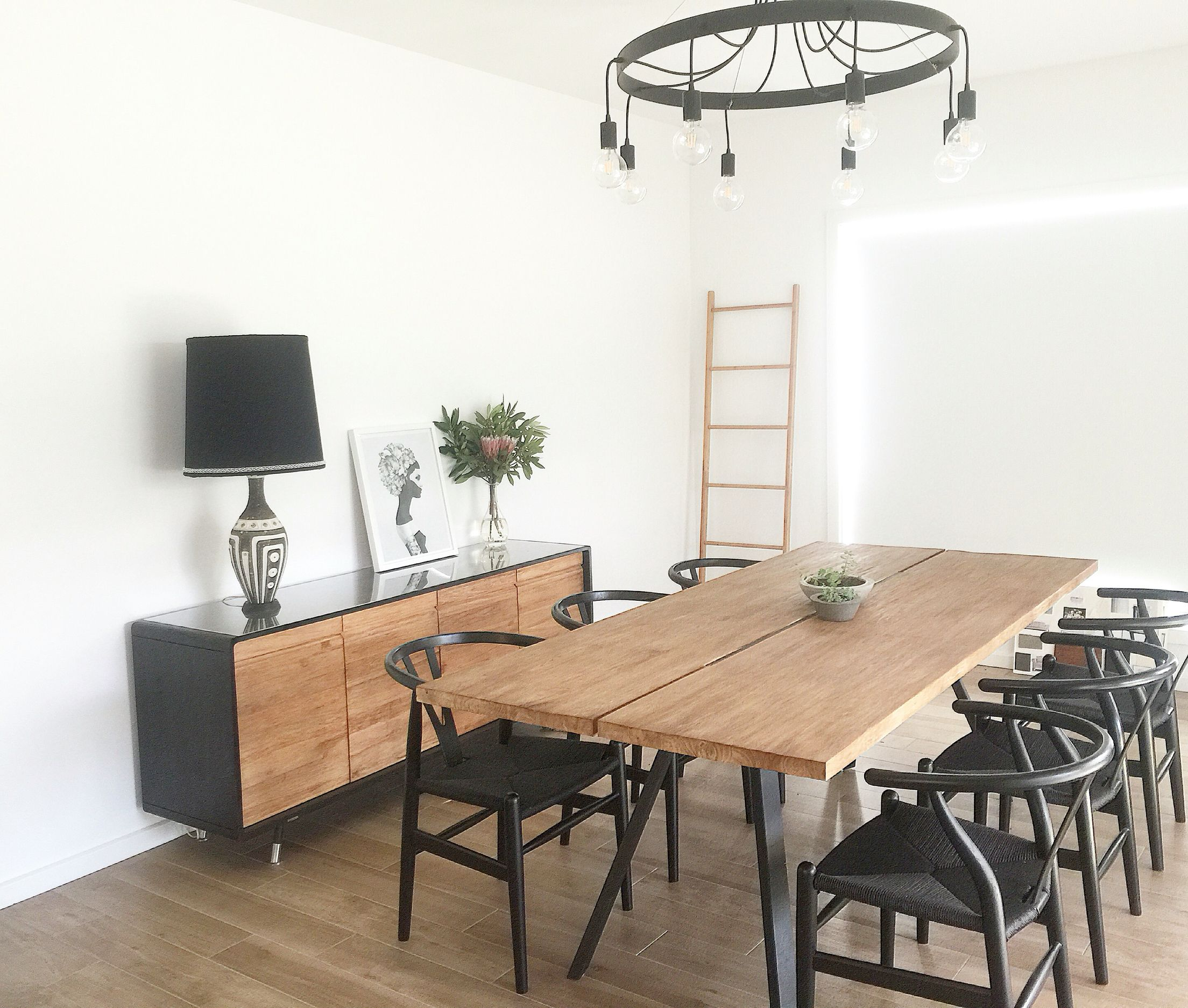 Dining room Inspo with wishbone chairs teak table and buffet