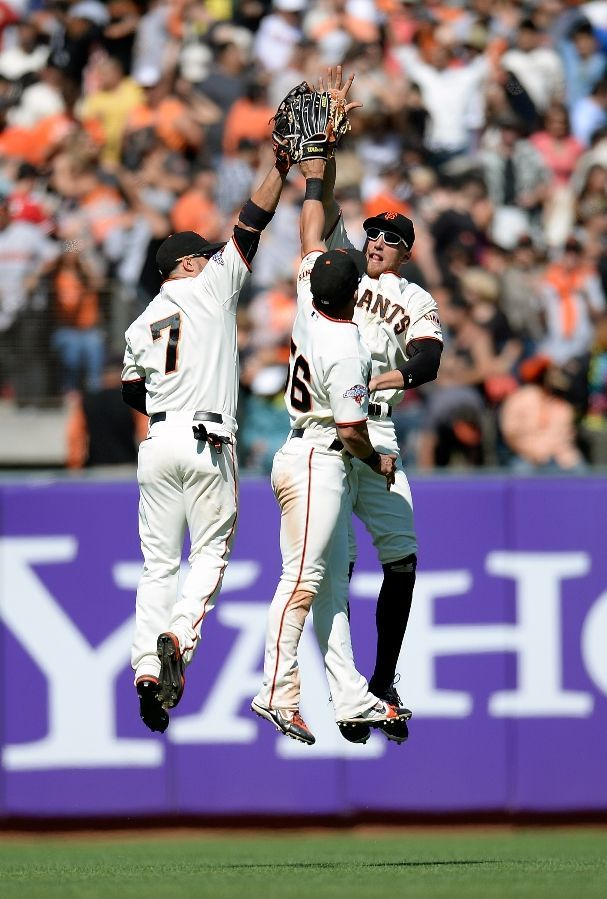 SAN FRANCISCO, CA - AUGUST 10: Gregor Blanco #7, Andres Torres #56 and Hunter Pence #8 of the San Francisco Giants celebrate defeating the Baltimore Orioles 3-2 at AT Park on August 10, 2013 in San Francisco, California. (Photo by Thearon W. Henderson/Getty Images)