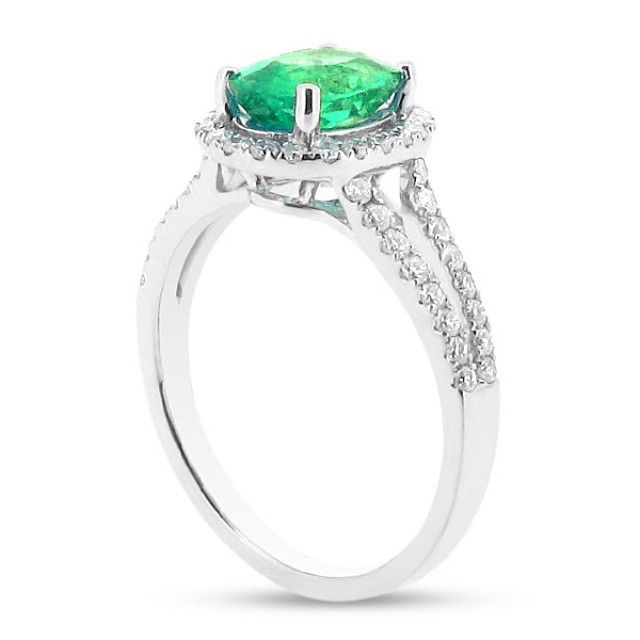 Oval Halo With Scallop Set Split Shank And Green Emerald Centre Stone #wedding #engagementring #diamonds #diamondring #engagementrings #jewellery #diamond #bride #ido #weddinginspiration #loveit #inlove #t4l #likeback #vsco #like #tagsforlikes #tags4like #likeback