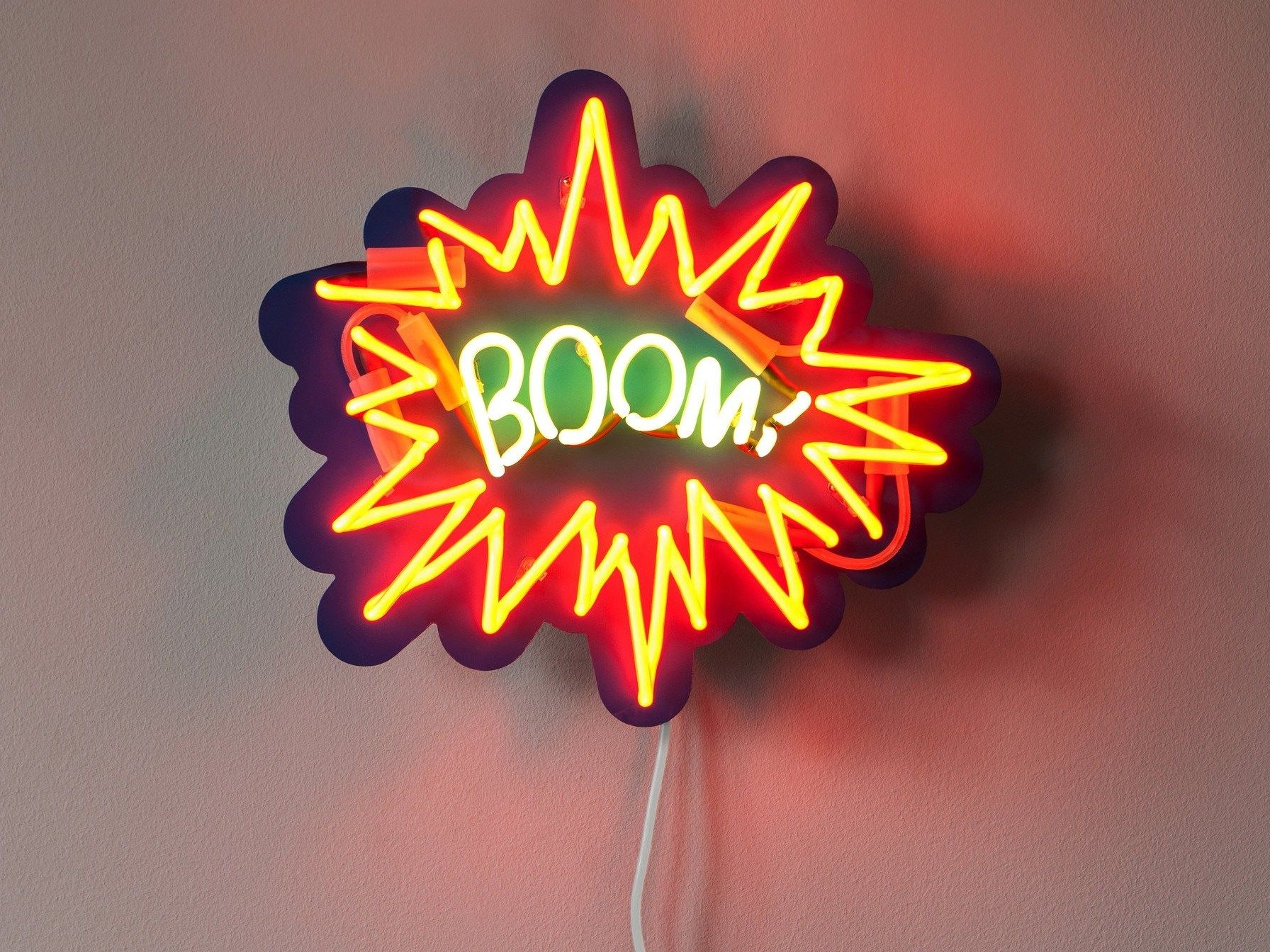Wall mounted neon light installation BOOM Sygns