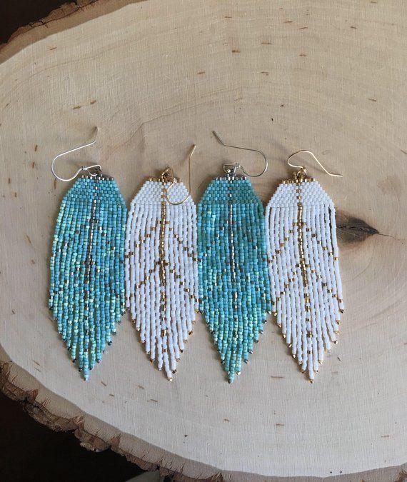 Items similar to Feather silhouette earrings seed bead earrings beaded earrings yoga jewelry spiritual jewelry Southwestern style earrings bohemian earrings on Etsy