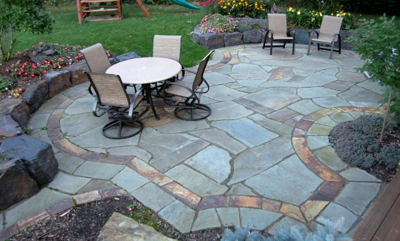 patio with a wall bluestone patio with sunset bronze insets