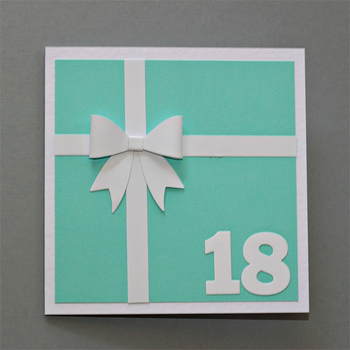 Teal Present With White Bow