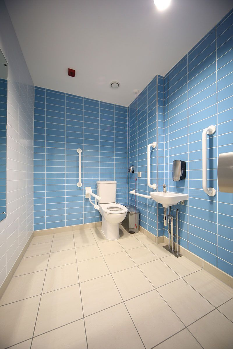 DDA bathroom at a commercial office project. Featuring bright and ...