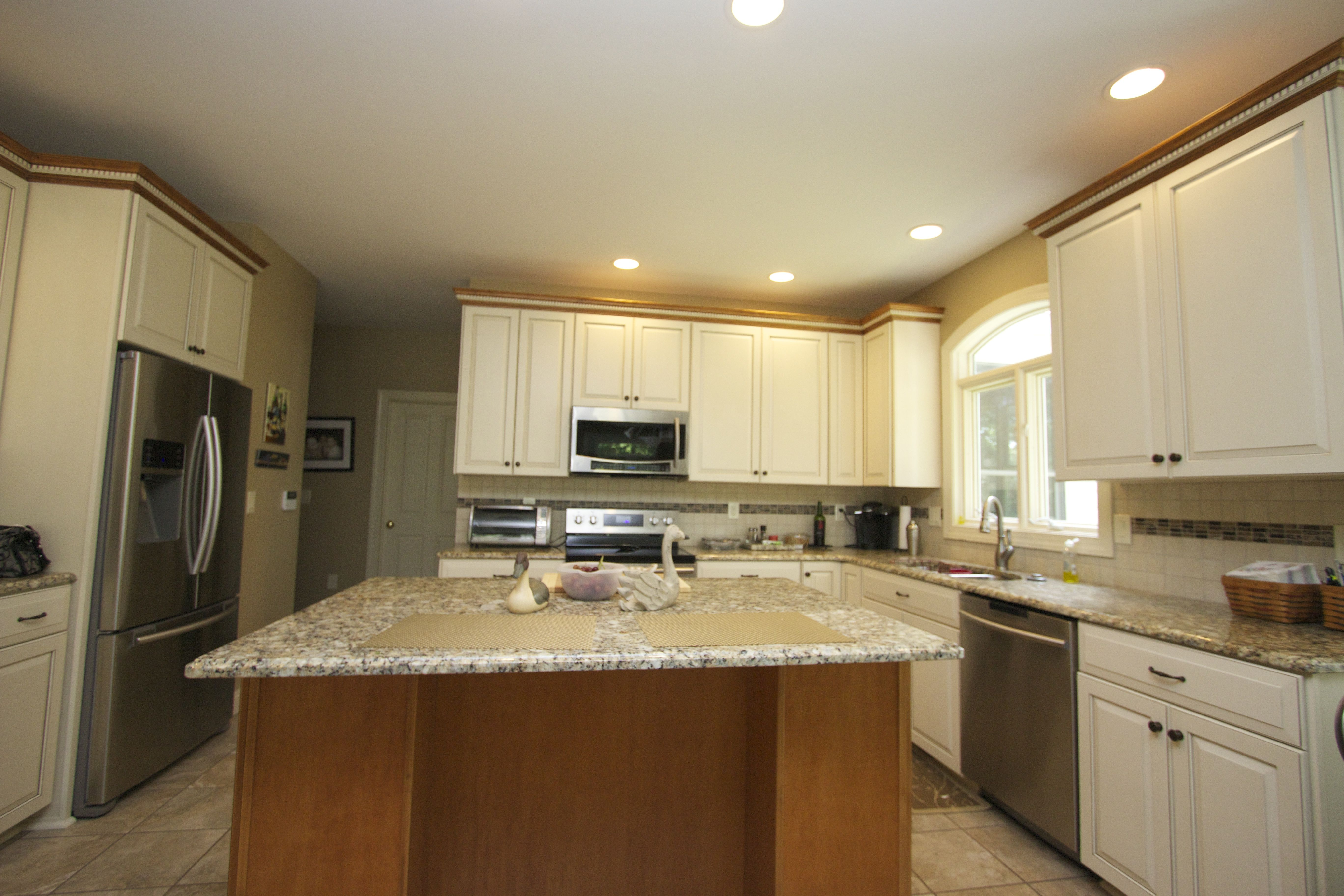 Transitional style kitchen in maple wood with crystal white stain