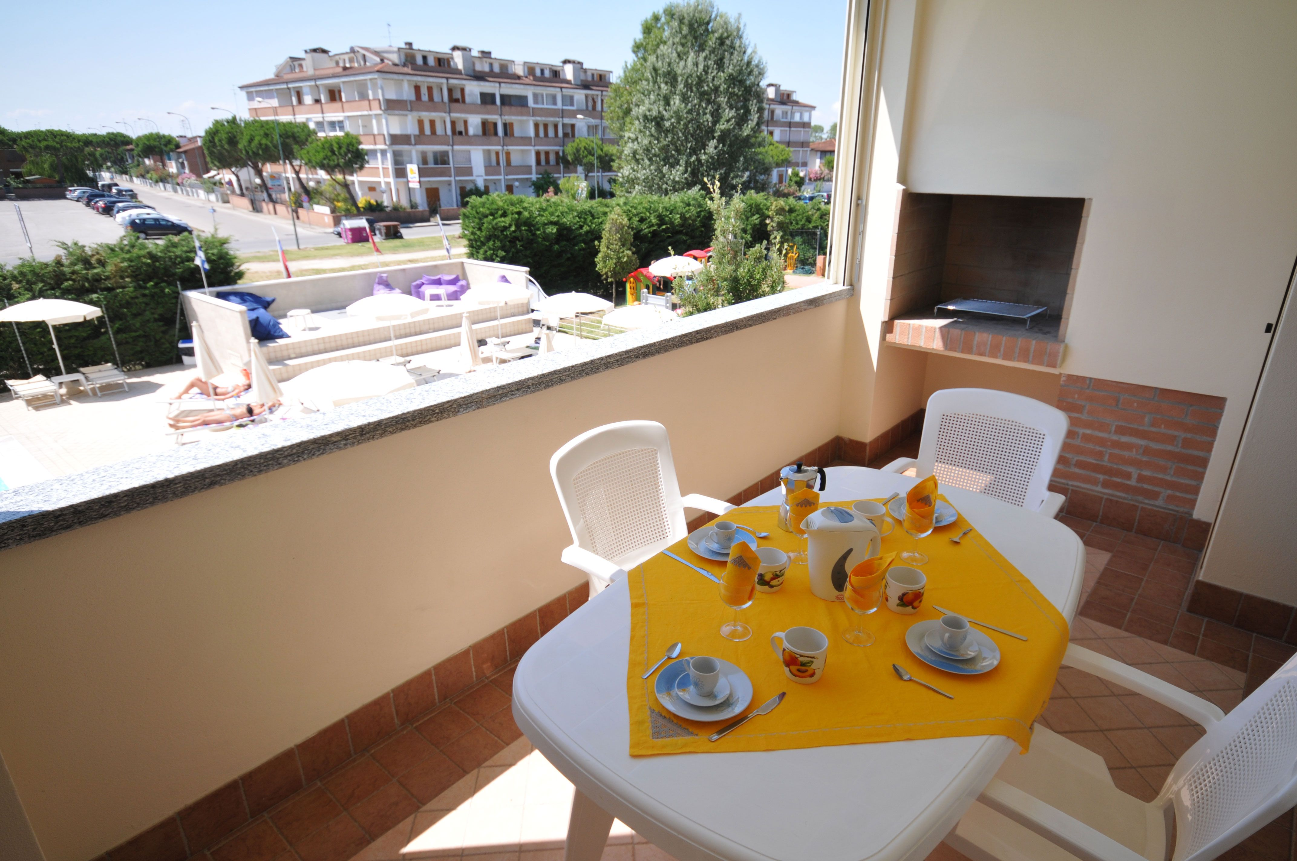 Balcony or terrace with table chairs and barbeque grill
