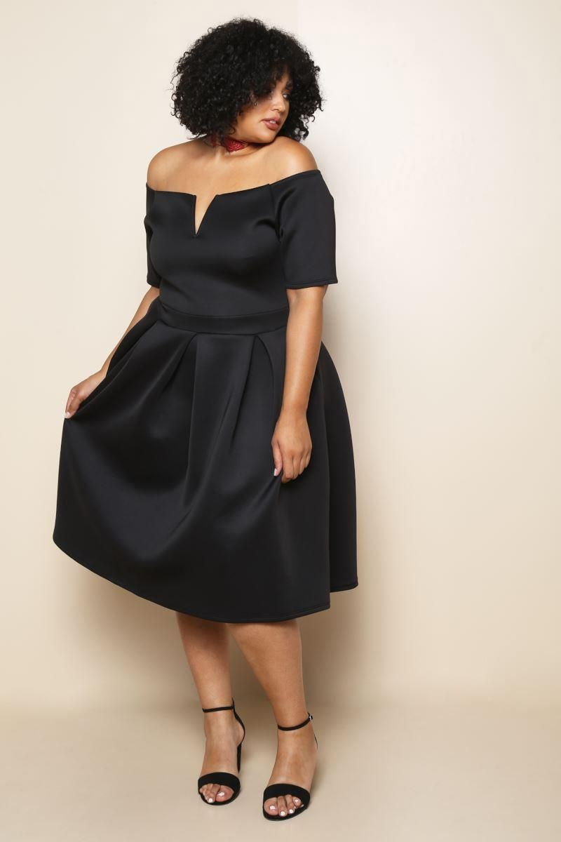 A polished plus size fit flare dress featuring a scuba fabric and