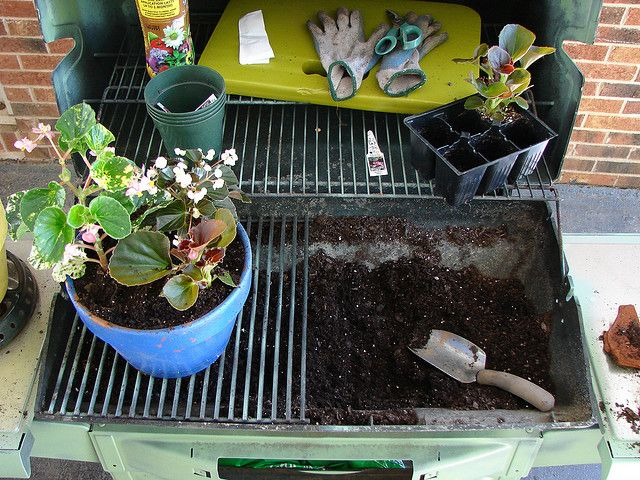 and old grill becomes a potting bench