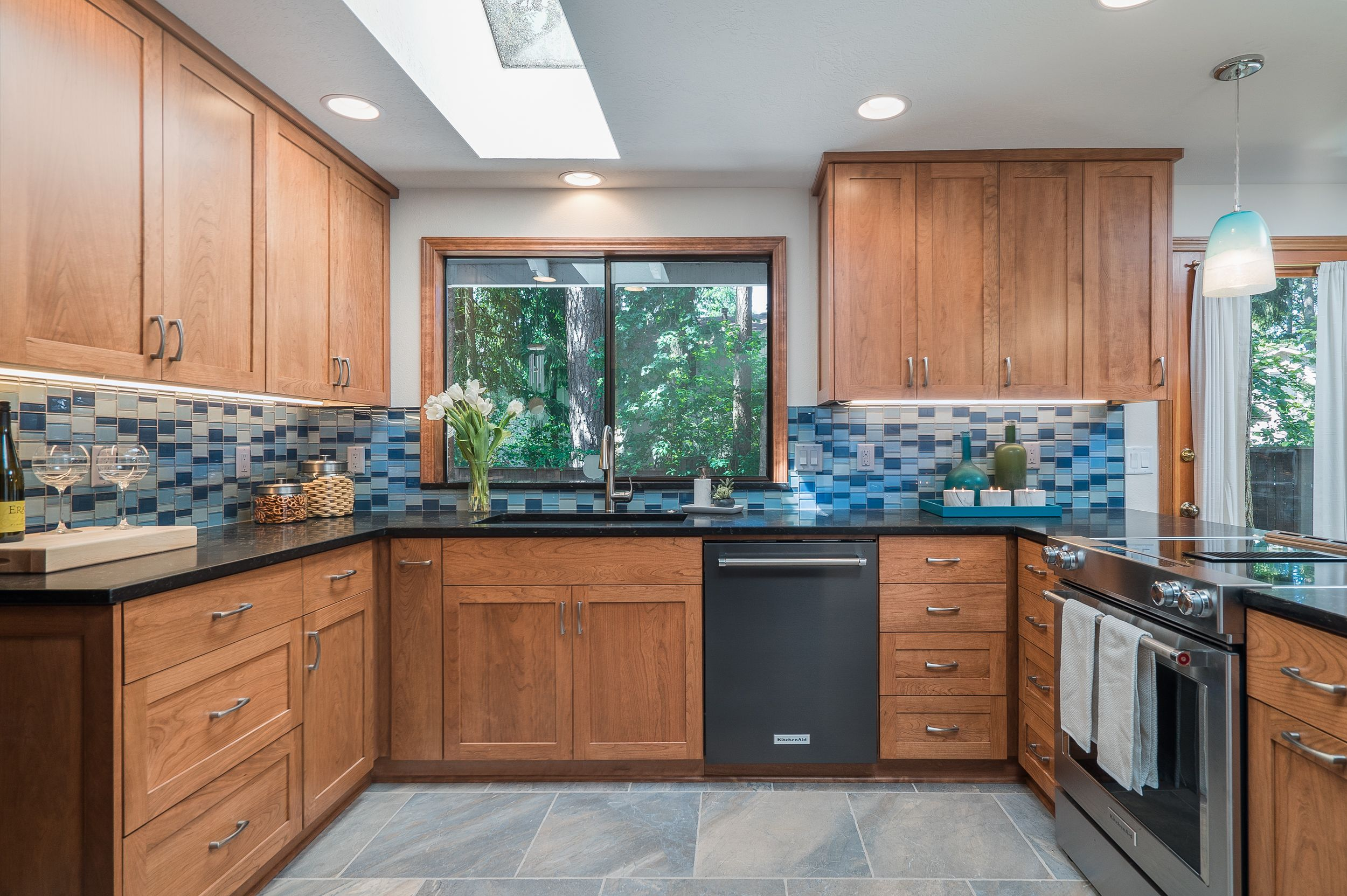 This Remodeled Kitchen In Beaverton Oregon Now Features Plenty Of Storage A Dynamic Backspl Kitchen Cabinets Kitchen Cabinets And Countertops Kitchen Design