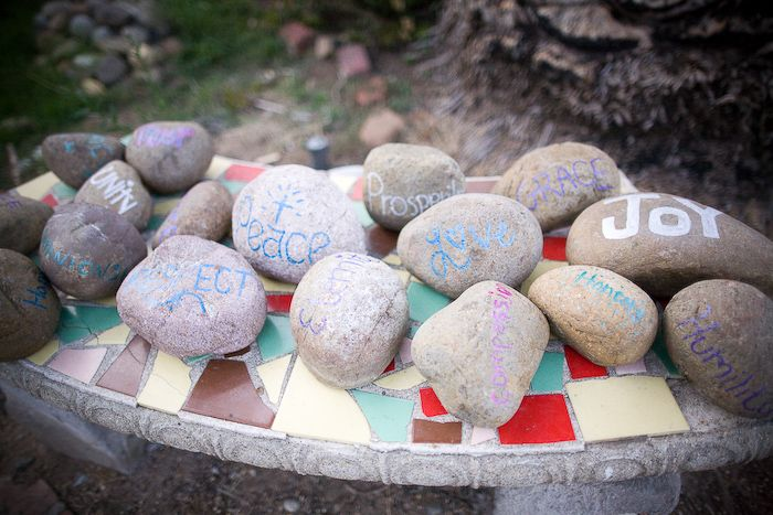 They had their bridal party carry rocks down the aisle. And on the rocks were words the bridal party hoped for their marriage. Donald and Amber's Wedding by The Yes Girls at Bandy Canyon Ranch