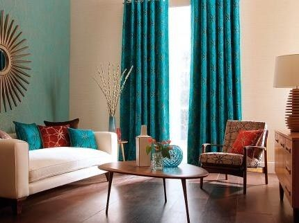 teal blue living room curtains grey black and purple ideas accent color on plain wall to match decor