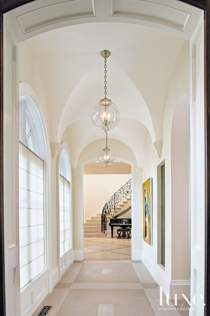 Traditional White Foyer With Groin Vaulted Ceiling Luxe