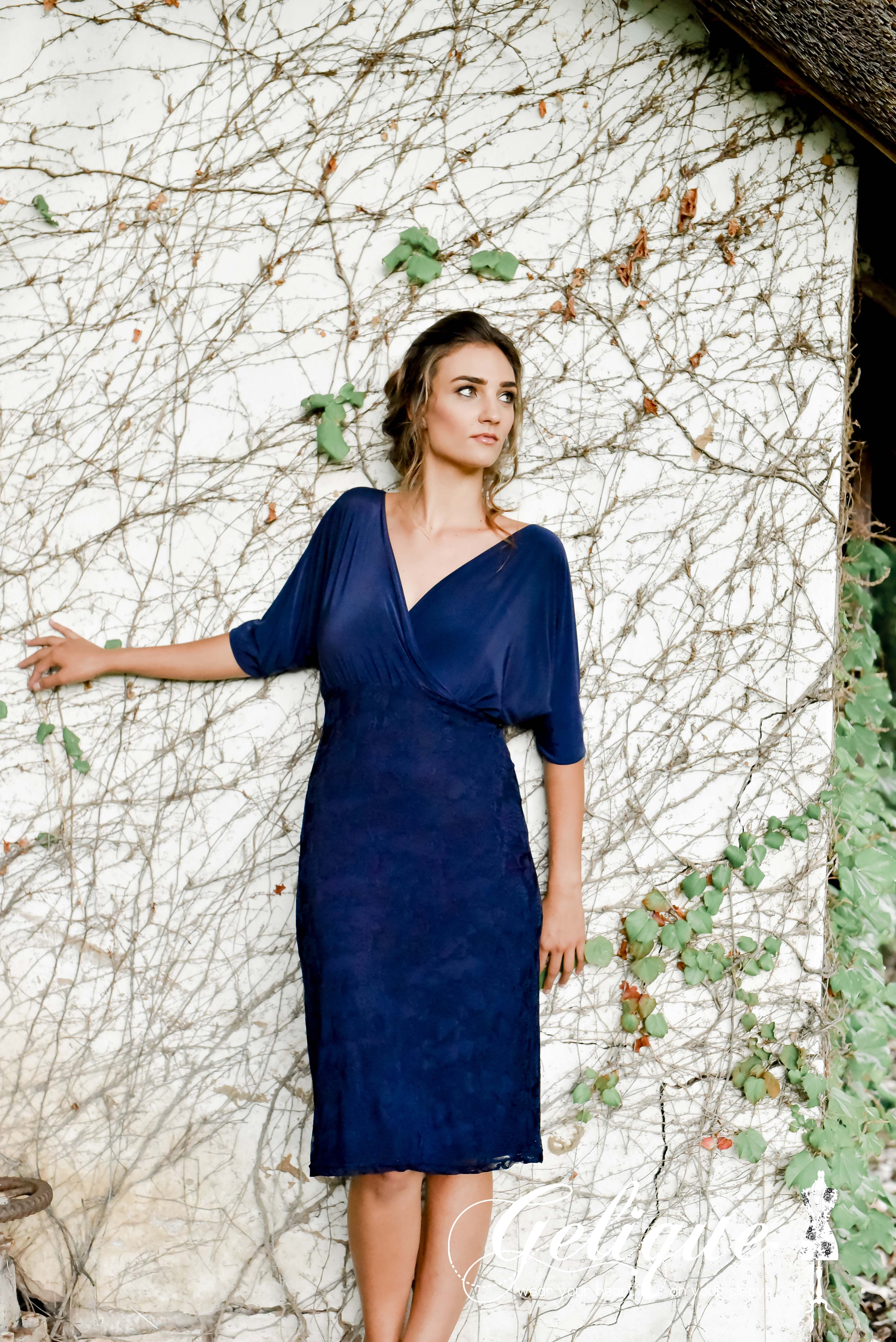 Juliet design Gelique bridesmaids dress. Navy bridesmaids dress. Flair sleeves. Plunging neckline and revealing back, the Juliet Dress will definetely make a bold statement..  Available in a variety of sizes and colours from Brides of Somerset. Long, knee-length or short available. Knee length bridesmaids dress.