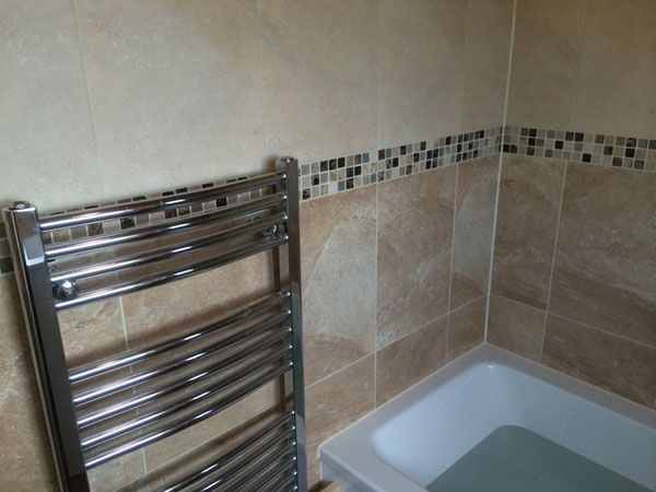 Mosaic Border Tiles in an installation project by UK Bathroom Guru