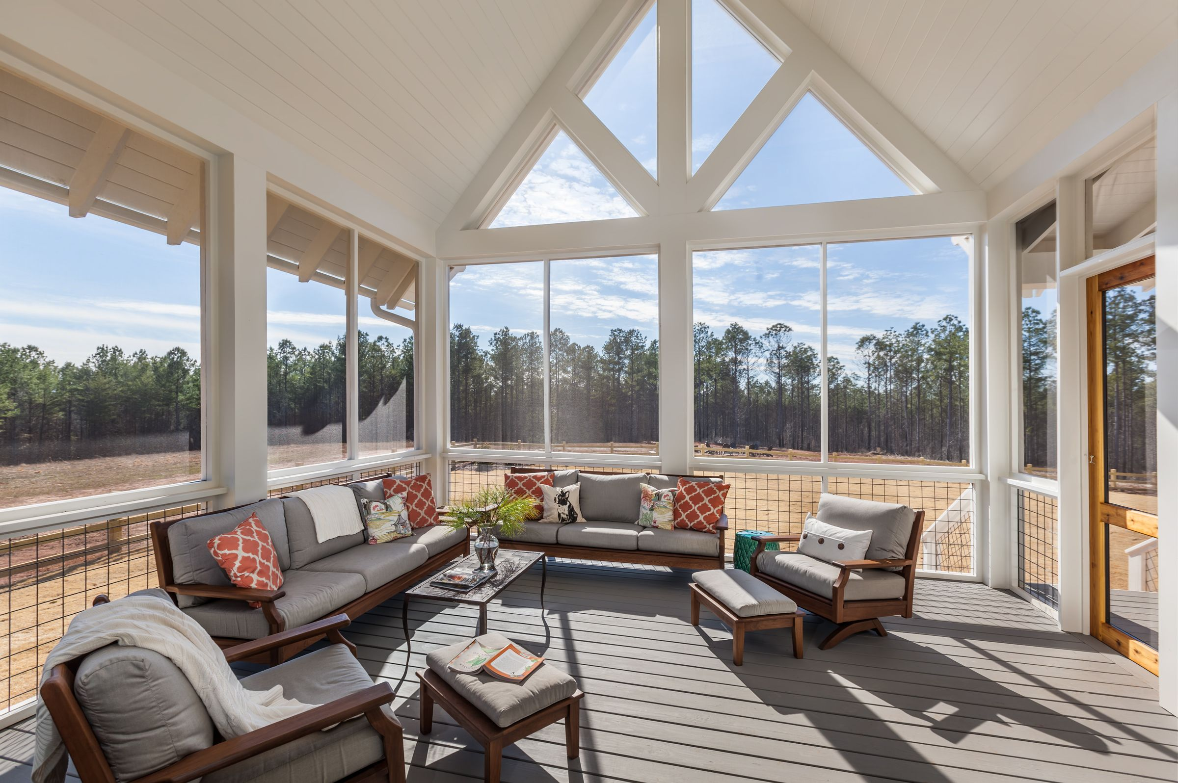 Vaulted Ceiling Screened Porch Is Created With Custom Touches And Easy To Maintain Materials The Beams And Colu Porch Cost Porch Design Screened In Porch Cost