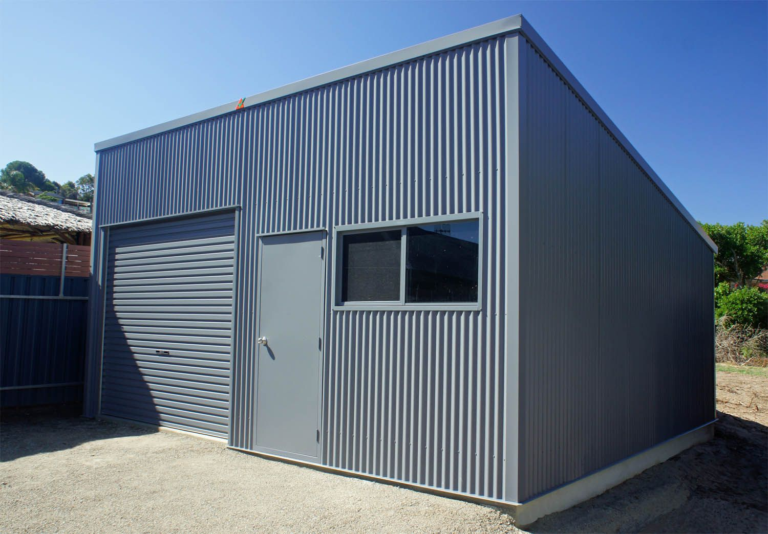 """A Skillion shed in Colorbond """"Basalt"""" with a 10 degree"""