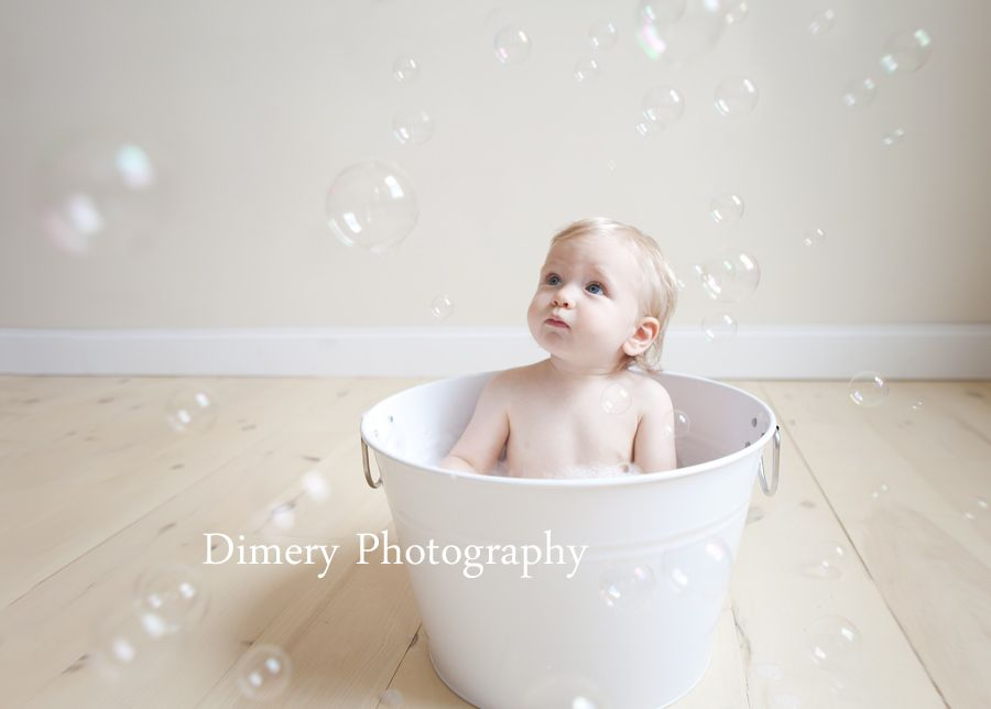 Bubble bath, one year old baby in white tub, bubbles, © Dimery ...