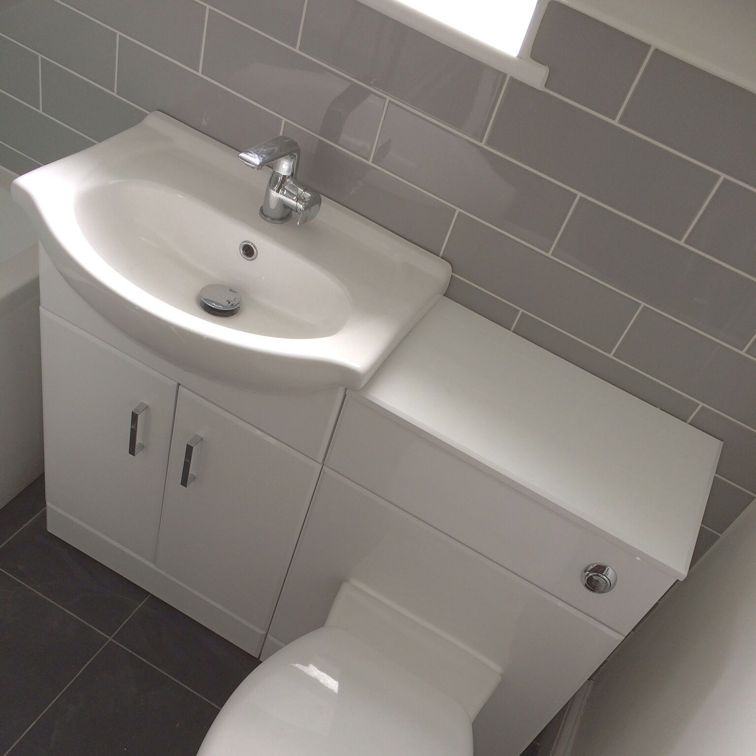 Beautiful Compact Basin And Wc On Gloss White Vanity Unit Stunning Linear Grey Brick Style Tiles Fr In 2020 Grey Bathroom Tiles Bathroom Vanity Units White Vanity Unit