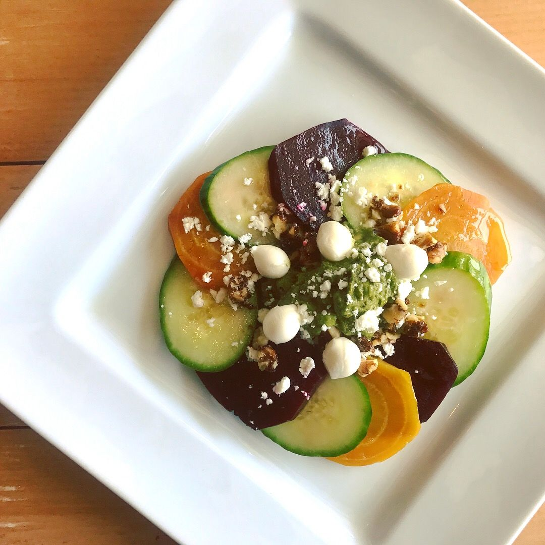 Red & Yellow Beets, Cucumber, Avocado-Basil Purée, Fresh Mozzarella Pearls, Crumbled Goat Cheese,  Candied Walnuts, Olive Oil, Salt & Pepper
