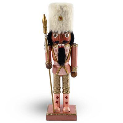 The Holiday Aisle® This soldier nutcracker is part of our rose gold collection. Clad in a fancy outfit and wearing a furry hat, this soldier adds style wherever he goes. His boots are adorned with sparkling rhinestones and he holds a spear with tassels. Color: Black