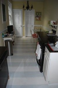 painted summer stripes on the kitchen floor