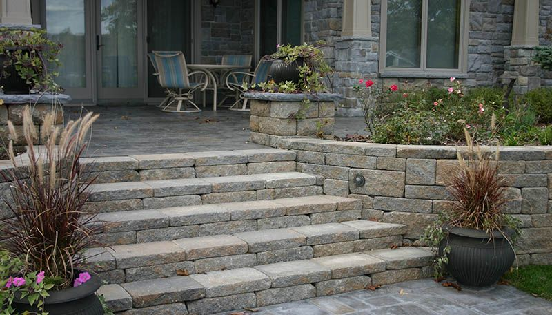 Potted plants, patio chair, paver patio, entryways, stairs ...